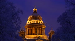 Old neoclassical orthodox basilica cupola at winter night, medium telephoto view Stock Footage