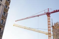 Construction site, building and cranes Stock Photos