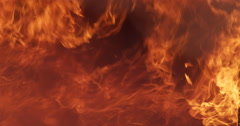 Slow-motion smoke and flames fill the screen - stock footage