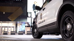 Police vehicle parked in front of mall entrance in snow 4k Stock Footage