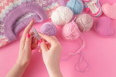 Womans hands with yarn ball and strings - stock photo