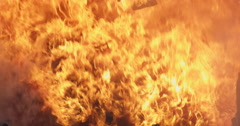 Falling debris in the middle of a surging fire - stock footage