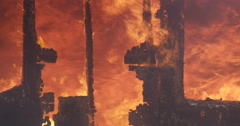 Raging fire seen through remains of a wall - stock footage