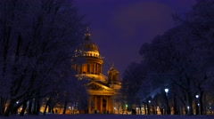 Saint Isaac Cathedral at night winter time, as seen from park area Stock Footage