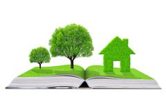 Ecological book with trees and house - stock photo