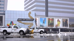 Snow plow trucks in front of Mall of America 4k Stock Footage