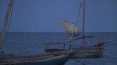 Boats at twilight on Indian Ocean near Zanzibar, Tanzania - stock footage
