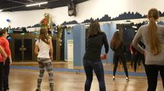 Female dance class group training salsa movements Stock Footage