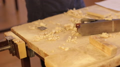 Carpenter work with Hand jack plane, wood chips Stock Footage