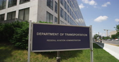 Close-up United States Department of Transportation sign at corner of Indiana - stock footage