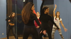 Female dance class group training salsa movements in mirror reflection Stock Footage