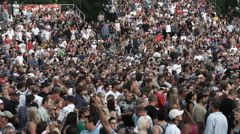 Crowd waiting for an outdoor performance to begin - stock footage