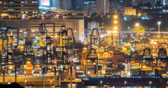 Busy container terminal of Hong Kong at night industrial background Stock Footage