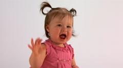 Baby girl in pink dress waving bye-bye Stock Footage