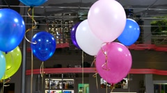 Helium balloons hang from the ceiling in the cafe celebration birthday - stock footage