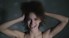 The curly-headed girl cheerfully laughs and dances Stock Footage