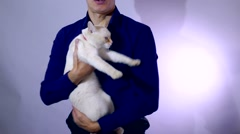Mad cat biting man hand Stock Footage
