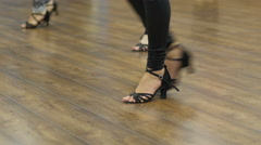 Feet in shoes on the floor - female salsa dance class group train movements - stock footage