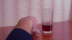 Businessman chooses between alcohol and family. And selects family - stock footage