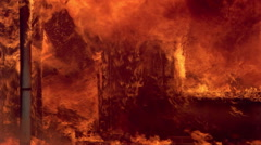Doorway engulfed in flames of  house fire Stock Footage