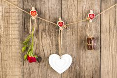 Red rose with white shape heart and chocolate on wooden Stock Photos