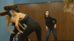 Female dance class group training salsa movements with dancing master Stock Footage