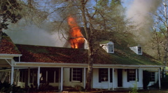 Flames and smoke pouring out of attic - stock footage