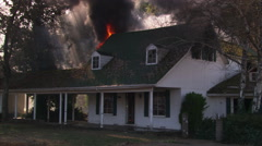 Burning interior seen through windows of house on fire - stock footage