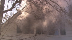 Smoke obscuring upper windows of  house on fire, close view - stock footage