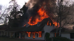Wide view of house fully engulfed in flame Stock Footage