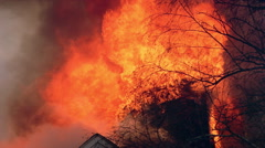 Flames towering above burning roof Stock Footage