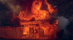 Burning house almost completely consumed by fire - stock footage