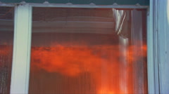 Flames of interior fire viewed from outside window - stock footage