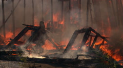 Flames still burning in collapsing rubble of  house fire - stock footage