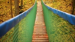 Suspended wooden bridge Stock Footage