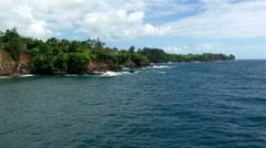 Low altitude flight along Hawaiian shoreline Stock Footage