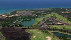 Flying over resort area near Kona, Hawaii - stock footage