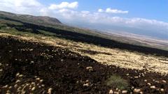 Flying over lava beds near Kilauea in Hawaii Stock Footage
