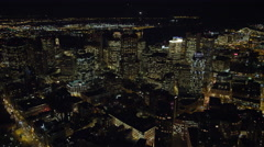 Flying over downtown Boston at night toward Financial District and waterfront. Stock Footage