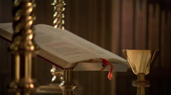 Priest's hand turning page during Eucharist Stock Footage