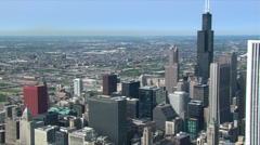 Stock Video Footage of Flying past skyscrapers to a view of sprawling Chicago. Shot in 2003.