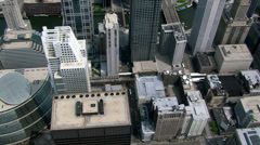 Flying over downtown Chicago rooftops. Shot in 2003. Stock Footage