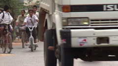 Little boys vying for attention on Cambodian street among uniformed Stock Footage