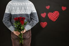 Composite image of mid section of man hiding red roses - stock photo