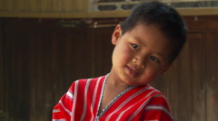 Portrait of shy Thai boy in red shirt Stock Footage