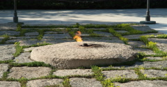 Close-up of Eternal Flame at JFK gravesite in Arlington National Cemetery, Stock Footage