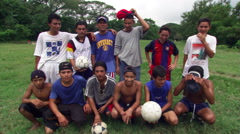 Group portrait of teenagers on a Salvadoran soccer team - stock footage