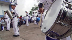 Young drummers in white uniforms playing at  parade in Salvadoran square Stock Footage