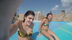 Girls Having Fun In Fun Slide On Water Park Stock Footage