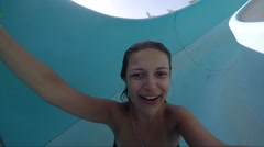 Girl Sliding Down a Water Slide Tube Stock Footage